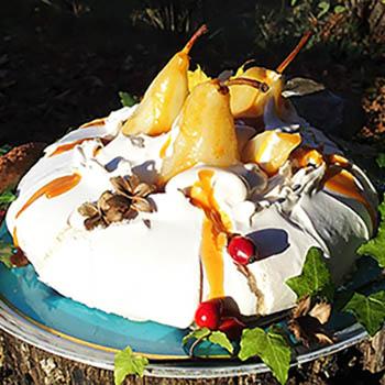 Pavlova meringue dessert with peas and salted caramel