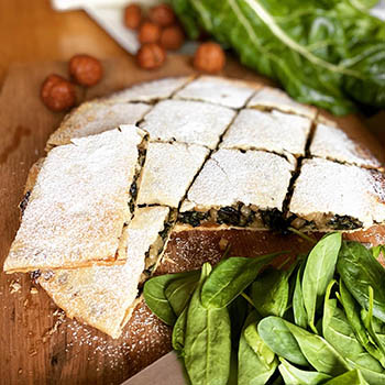 French chard pie with pine nuts and mushrooms