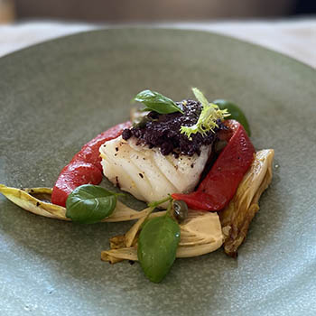"""Pan fried cod with back olives tapenade, chicory """"rôti"""", baked peppers and basil"""